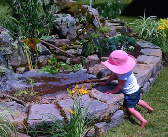 child at pond