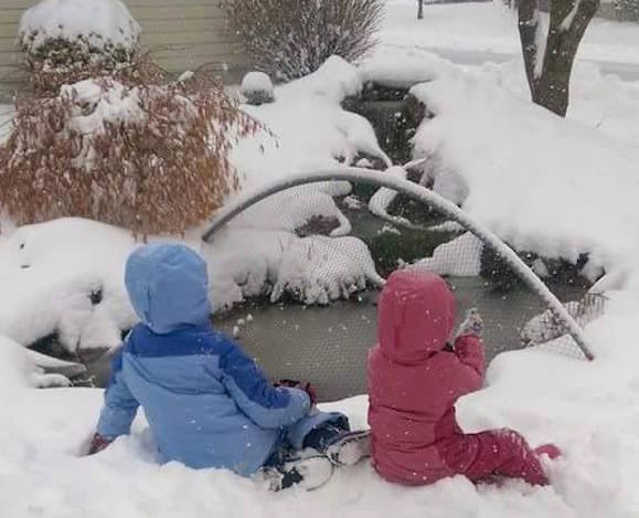 the girls in snow pond
